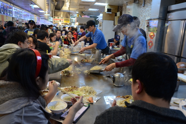 Crowding around the grill at Shilin Market