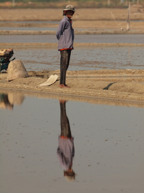 Salt pan worker in Thailand