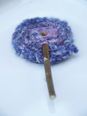 finger knitted Waldorf flowers