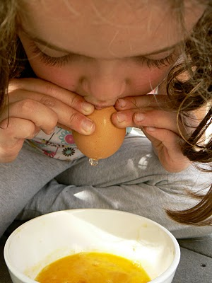 blowing the egg out of the egg shell
