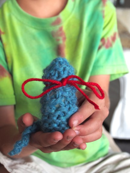 Photo of a yarn cat knitted by a kid