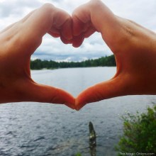 Photo of the lake and hand heart