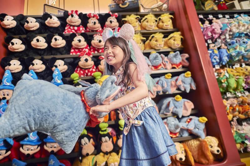 Girl with Disney plushes at Shanghai Disneyland Resort