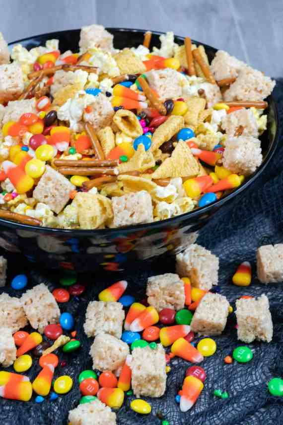Easy Halloween Treats for School Sweet Salty Halloween Snack Mix bugles, rice krispies, candy corn, pretzel sticks, M & M's, chocolate candies