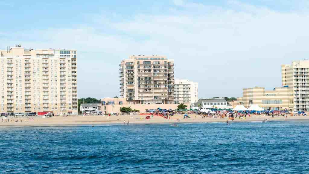 Virginia Beach Ocean view hotels resorts people umbrellas dolphins tour