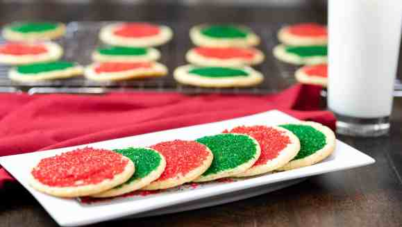sanded sugar cookies christmas thanksgiving white plate wire rack red napkin glass of milk