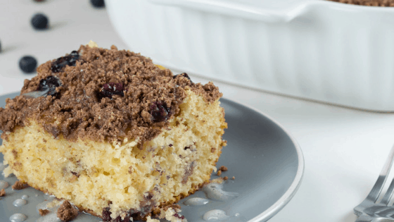 blueberry crumb cake white background with blueberries