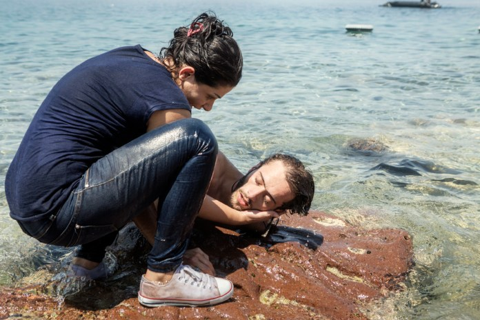 Lesbos, Greece, August 05, 2015. A Syrian who swam to shore after the boat he was on began to leak off shore. His condition was critical, but fortunately, around an hour later, a local doctor came and managed to assist, saving his life. According to UNHCR, approximately 850,000 refugees and migrants, including children, arrived in Greece by sea in 2015. Of these, just over 500,000 landed on the island of Lesbos. © Alessandro Penso
