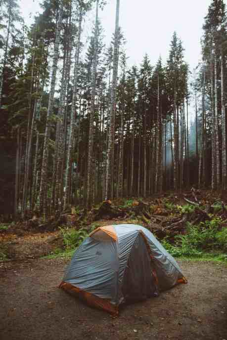 Are you ready for surviving camping in the rain? We've done it in the Pacific Northwest numerous times and we're sharing all our secrets!