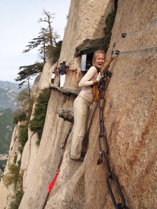 woman walking on dangerous cliff