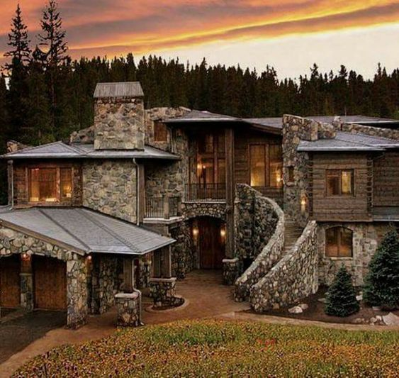 large stone and wood mansion