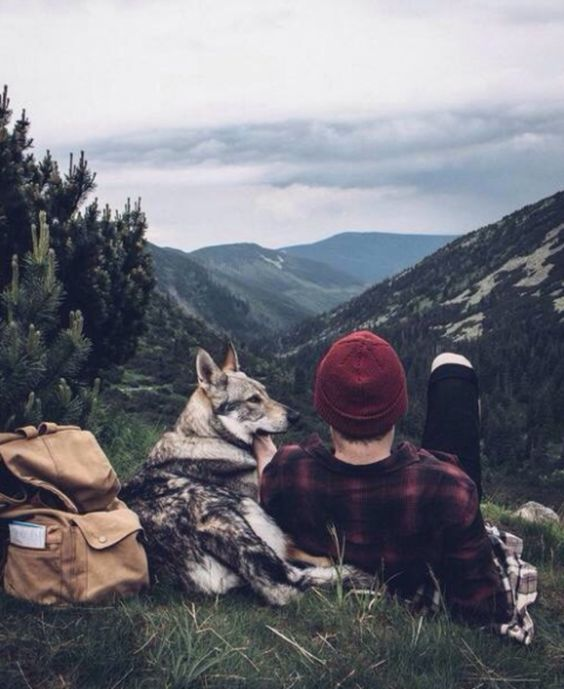 man and dog resting after hike
