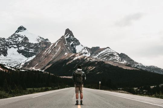 man admires mountain scenery