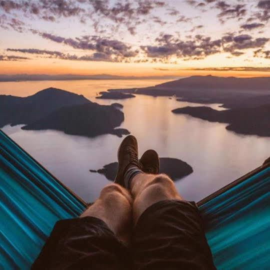 man in hammock enjoying an epic view
