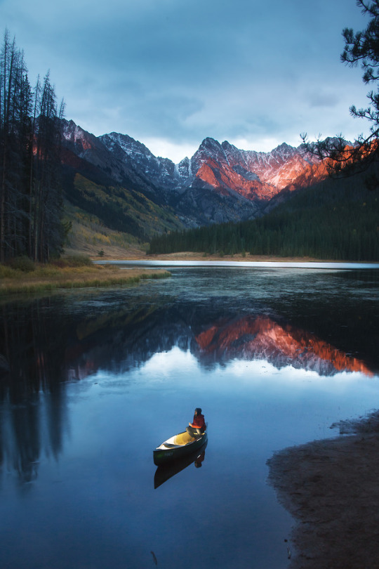 mountain lake with woman in boat