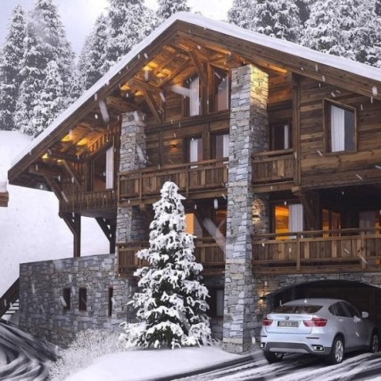 bmw parked in driveway of snowy cabin