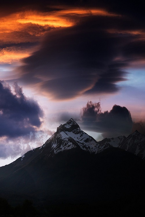 colorful clouds and snow capped mountain