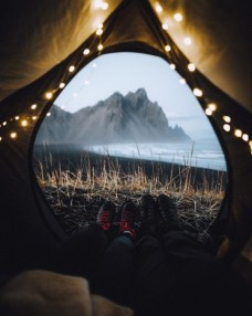 couple with great mountain view from tent
