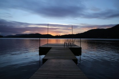 dock on a lake at sunset