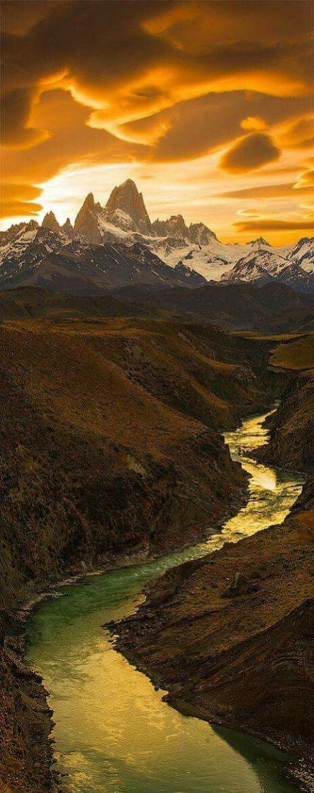 dramatic sunrise mountains and river