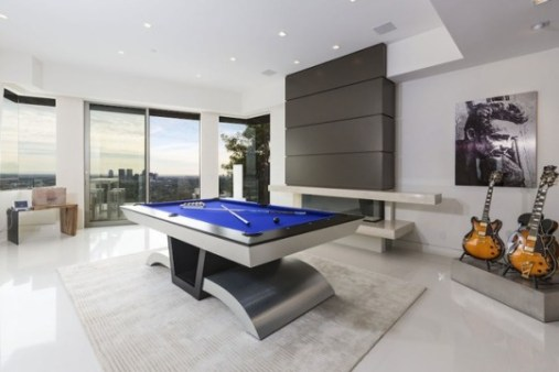 modern room with guitars and pool table