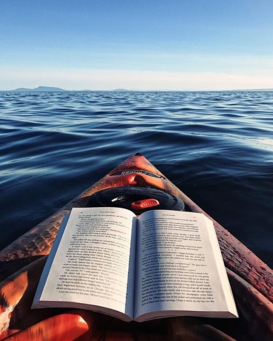 reading while rowing in a canoe