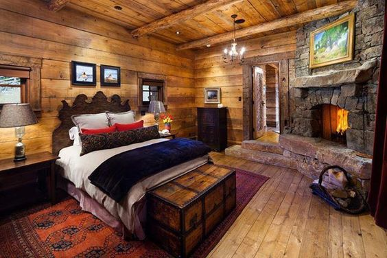 rustic bedroom with fireplace