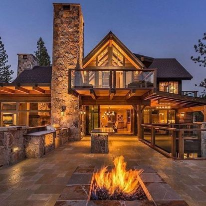 rustic home with outdoor kitchen and fire pit