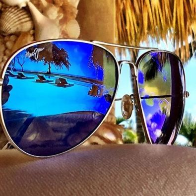 sunglasses reflecting beach scene