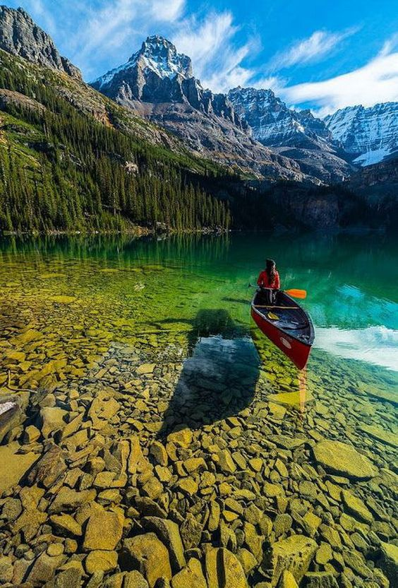 clear water mountain lake and canoe