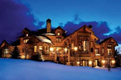 huge rustic home in the snow