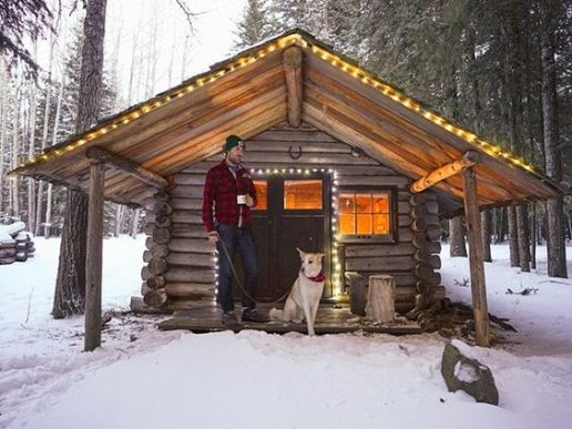 man dog cabin