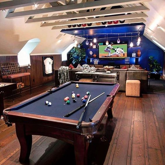 manly game room with pool table and big screen tv
