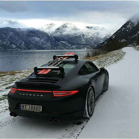 porsche in the snow with ski rack