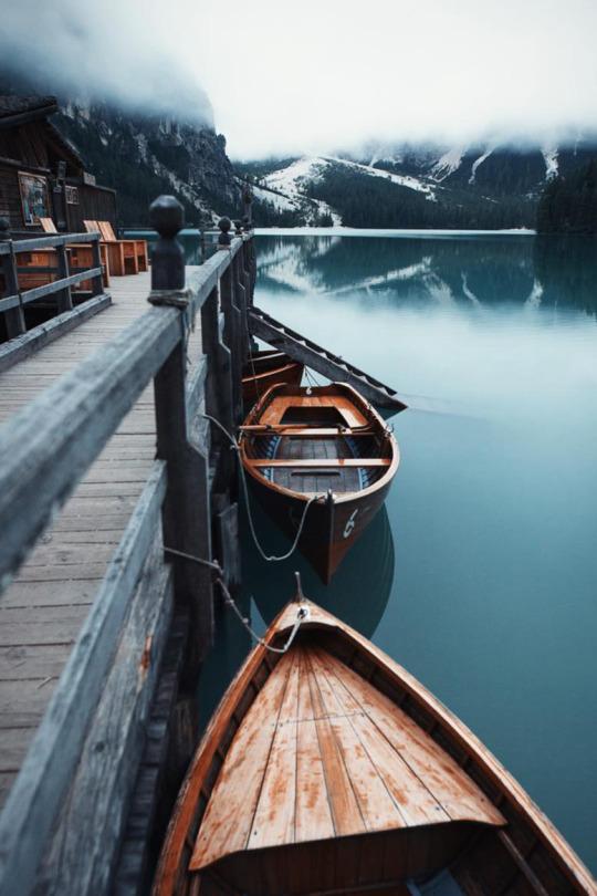 boats docked on a lake