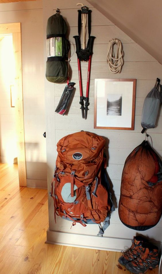 hiking gear hanging on wall