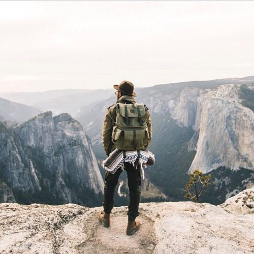 man looking out over mountain range
