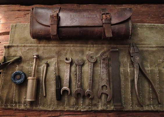 old tools with roll up case