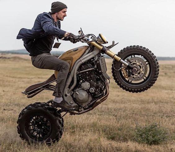 man doing wheelie on motorcycle