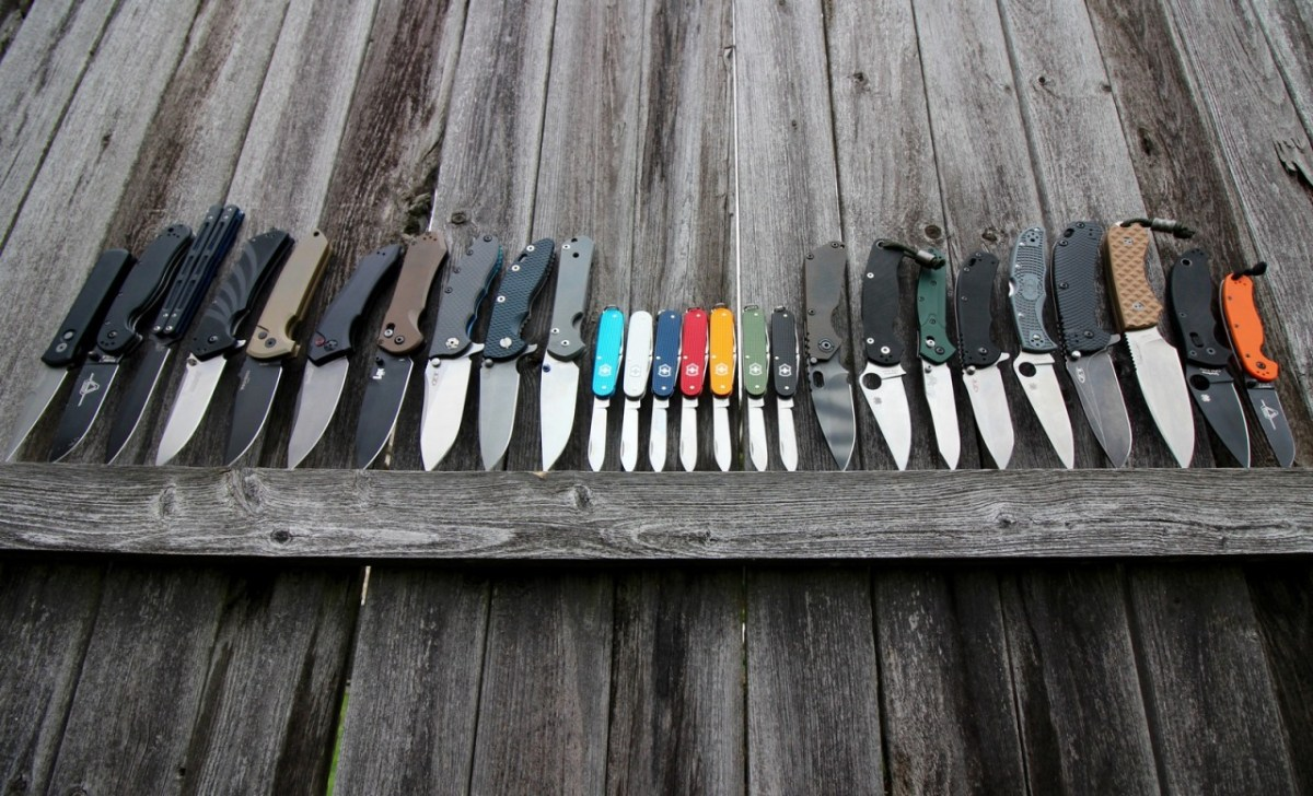 knife collection on fence