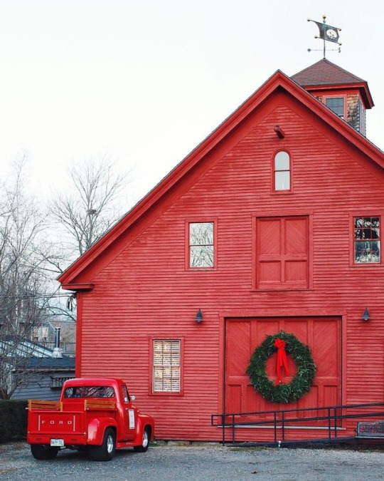 red christmas barn and red truck
