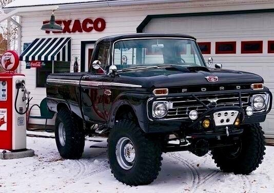 old ford pickup in front of tecaco station and snow