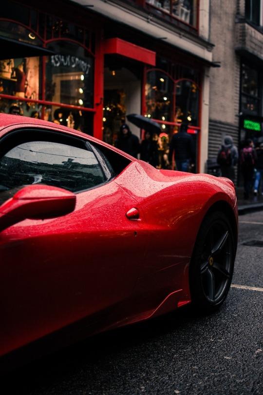 red ferrari parked on street