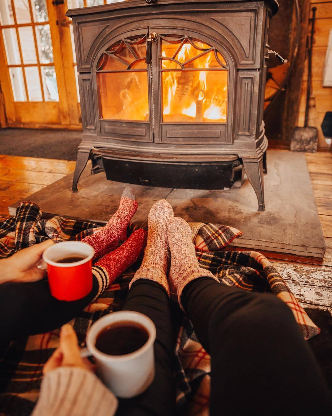 couple getting cozy by the fire
