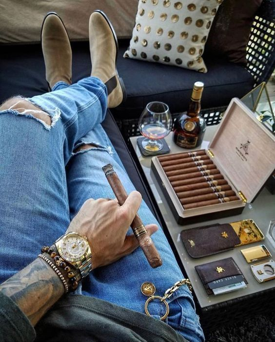 man relaxing with cigars