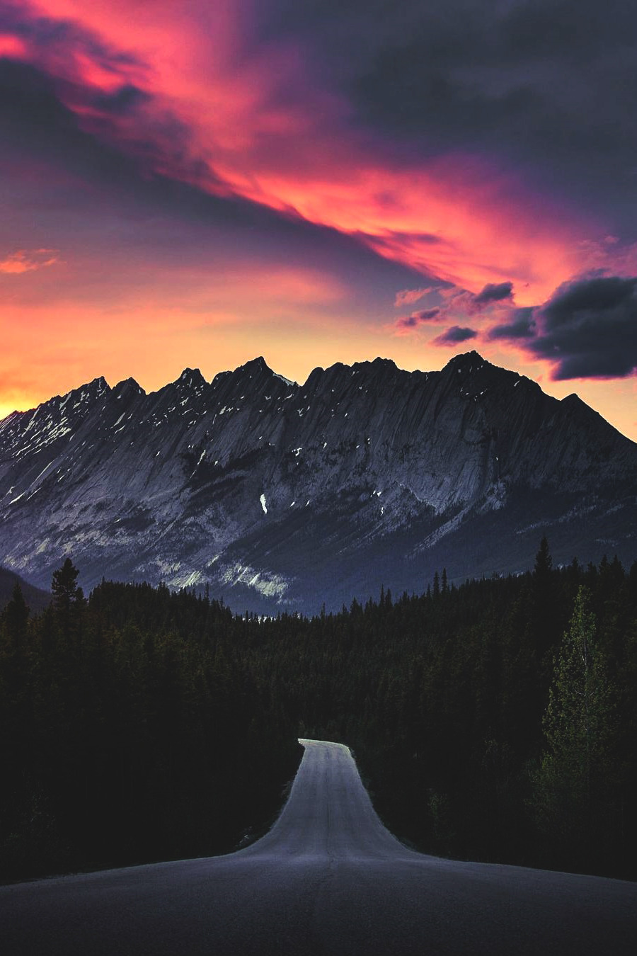 mountain road with dramatic sky