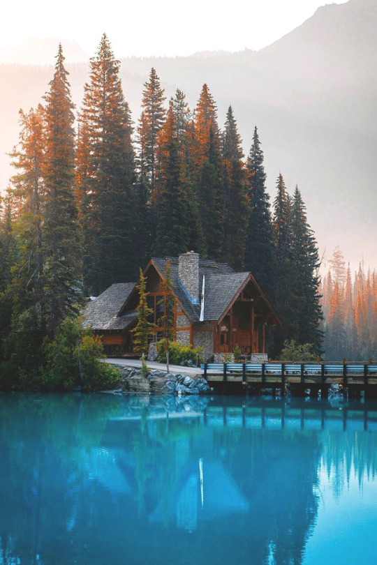 cabin on clear blue lake