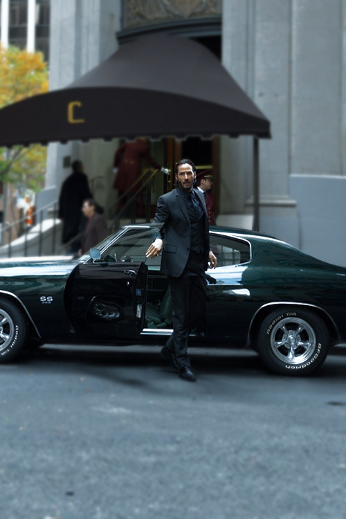 keanu reeves getting out of muscle car