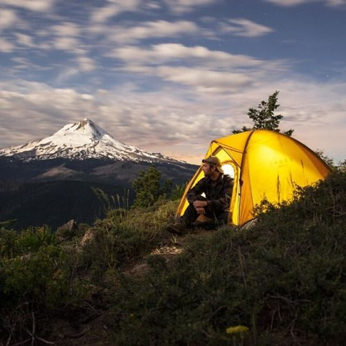 man solo camping in mountains