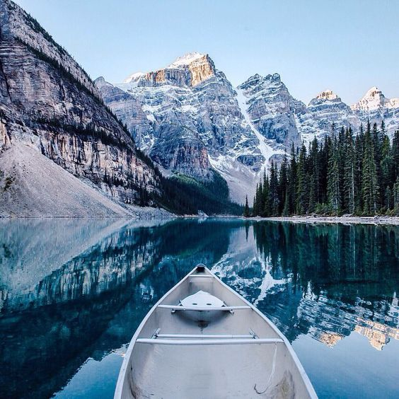 canoeing through mountain lake in winter